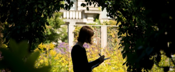 Woman reading in Cornell Botanic Gardens