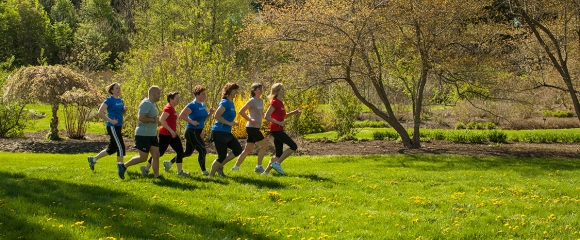 A running club enjoys spring in the F. R. Newman Arboretum.