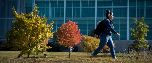 Student walking in the fall