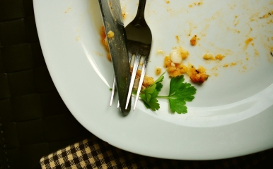 Empty plate with some food residue