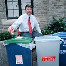 Walter Smithers, university solid waste manager, shows off recycling bins in the Law School atrium.