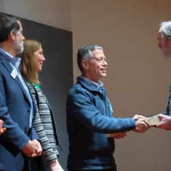 Staff member receiving sustainability award