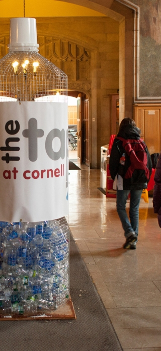 An oversized water bottle with facts on waste encourages passerbys to rethink plastic bottled water use