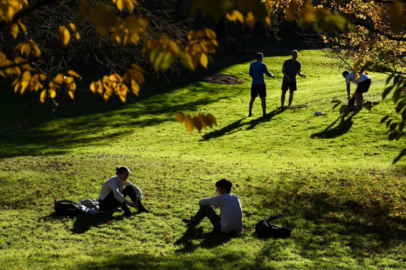 Students relax in the clearing by Sage Hall after class in October.