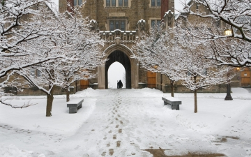 Snowy footprints leading to Baker Tower