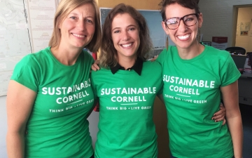 Three staff wearing sustainability t-shirts