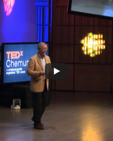 Mike Hoffmann lectures on stage at TedX in Chemung River