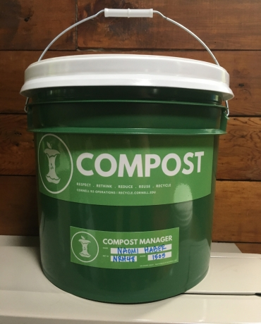 compost collection bucket with residential hall labelled